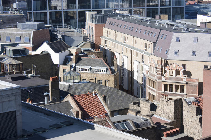 Rooftops and skyline in london. Rooftops view across east london to the business district stock photos