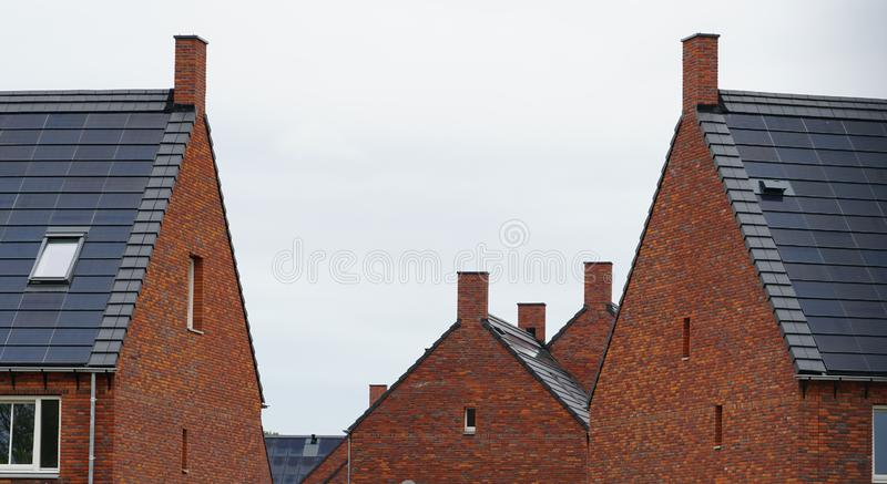 Rooftops with solar panels royalty free stock photo