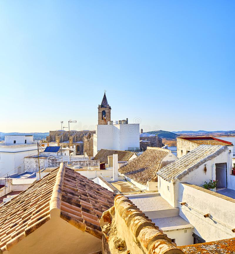Vejer de la Frontera downtown. Cadiz province, Andalusia, Spain. Rooftops view of Vejer de la Frontera downtown with the Bell tower of the Divino Salvador church stock photo