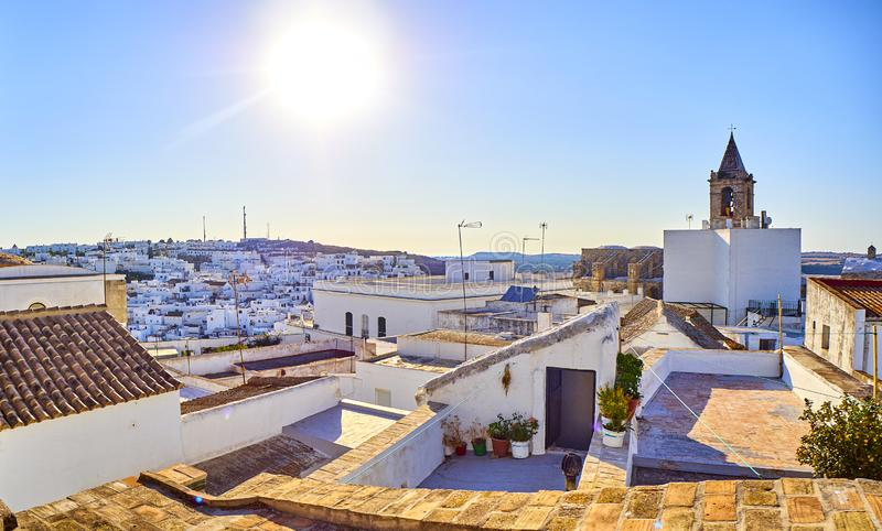 Vejer de la Frontera downtown. Cadiz province, Andalusia, Spain. Rooftops view of Vejer de la Frontera downtown with the Bell tower of the Divino Salvador church royalty free stock image