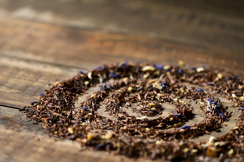 Rooibos mixed with flowers, dry fruits and herbs stock images