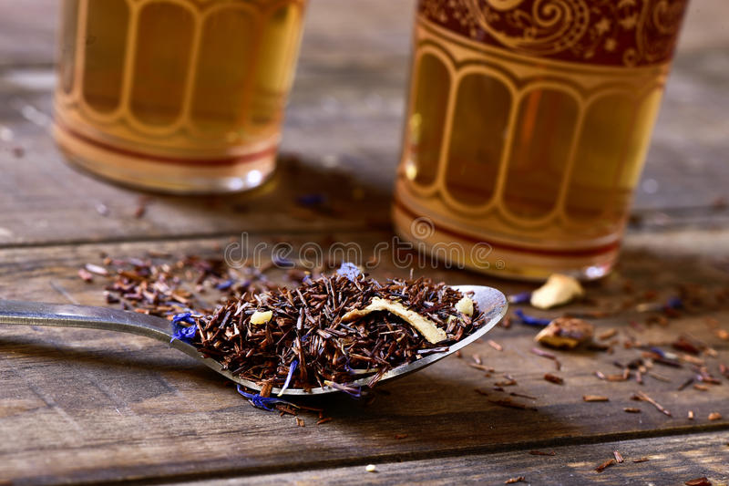 Rooibos tea mixed with flowers, dry fruits and herbs royalty free stock images