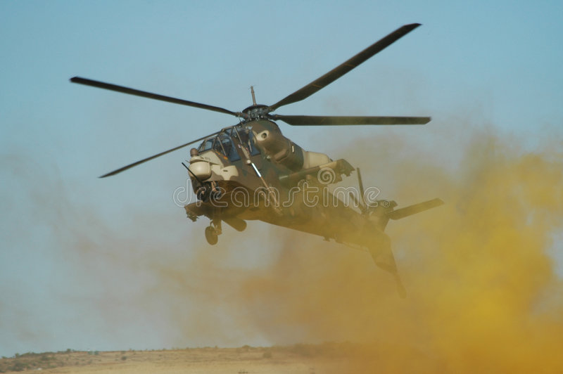 Rooivalk attack helicopter in battle royalty free stock image