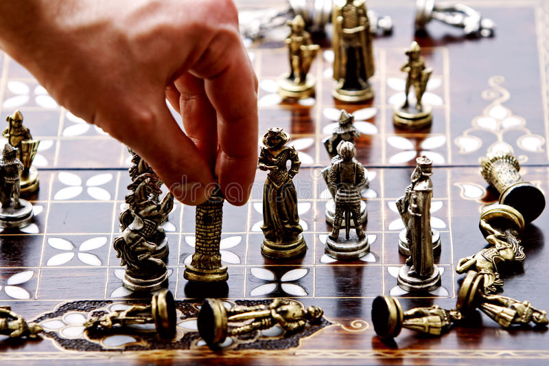 Rook Checkmate. Human hand moving black rook to checkmate white (Karpov Kasparov 1985 stock image