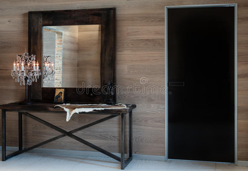 In the room are antique mirror and brass crystal light. Modern interior design of hallway. stock photos