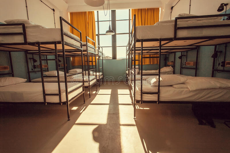 Room with big window inside the backpackers hostel with modern bunk beds stock photography