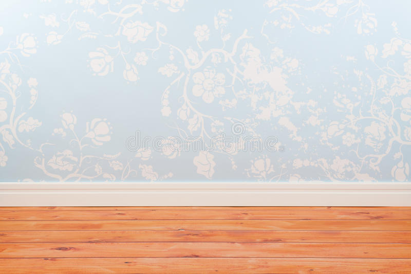 Room with blue vintage wall paper royalty free stock image