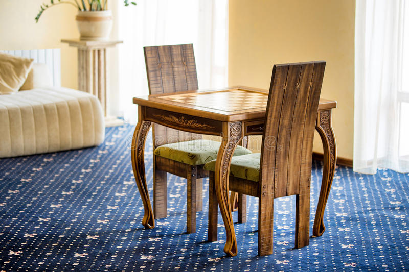 Room with chairs and table for playing chess game. stock photos