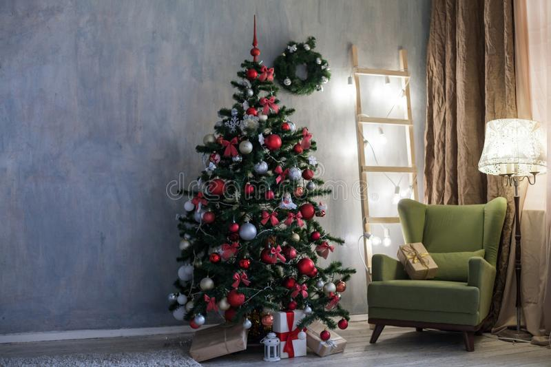 Room with Christmas decorations Christmas tree gifts stock images