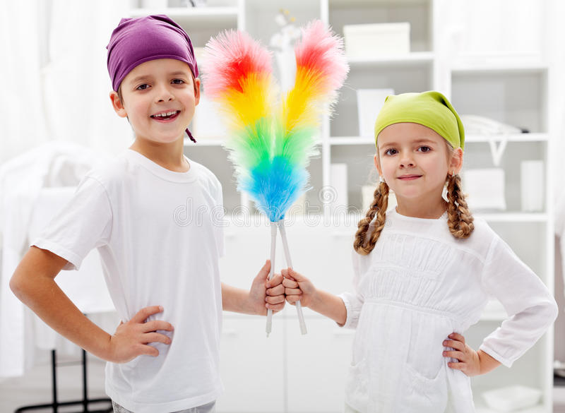 Room cleaning taskforce - kids with dust brushes. Preparing to tidy up royalty free stock images