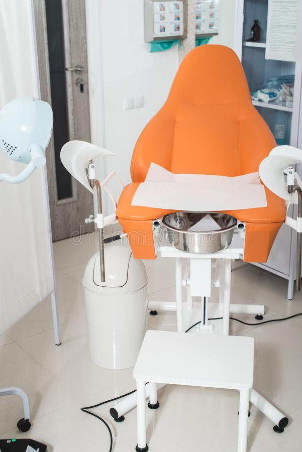 Room in the clinic with empty gynecological chair. royalty free stock photos