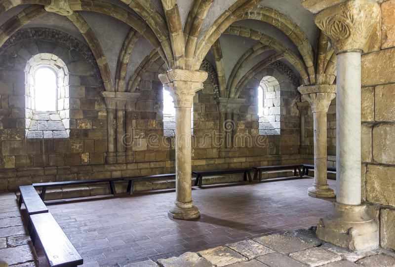 A Room At The Cloisters. An old room at the Cloisters showcases an old Gothic architectural space with pillars and vaulted ceilings royalty free stock photo