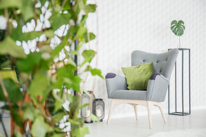 Room with 3d wallpaper. White modern room wth 3d wallpaper, armchair and decorative plant royalty free stock image
