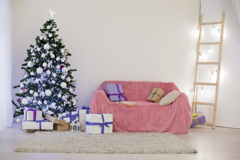 Room decorated for Christmas new year tree gifts royalty free stock photography