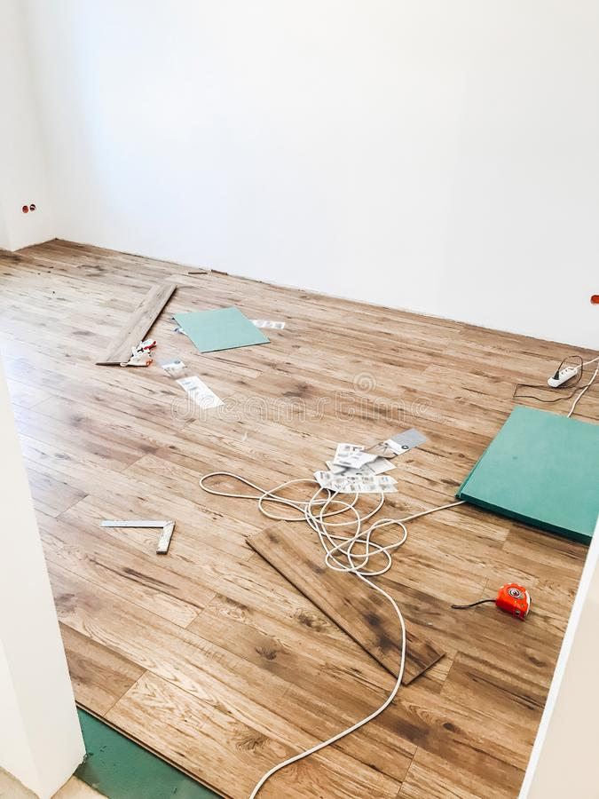 Room floor renovation concept. stylish wooden laminate instalation, modern white walls. repairing and working in home, space for. Text. hardwood plank parquet stock images