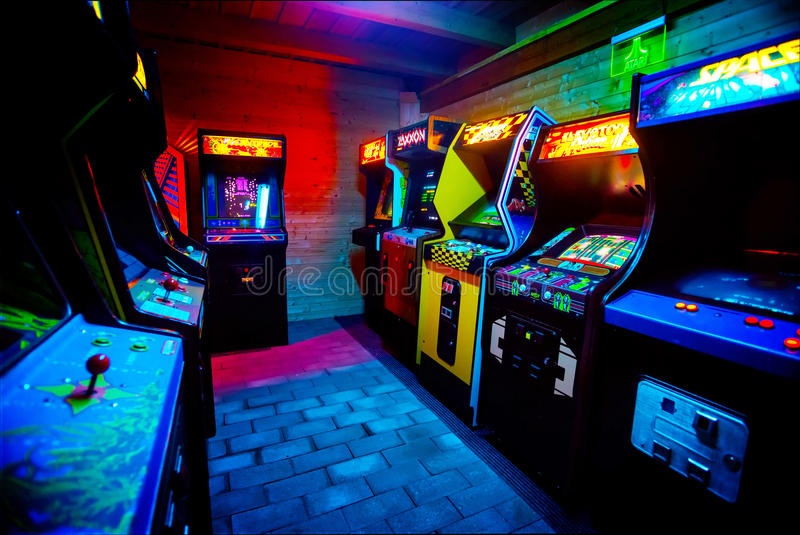 Room full of of 90s Era Old Arcade Video Games in Gaming Bar stock photos