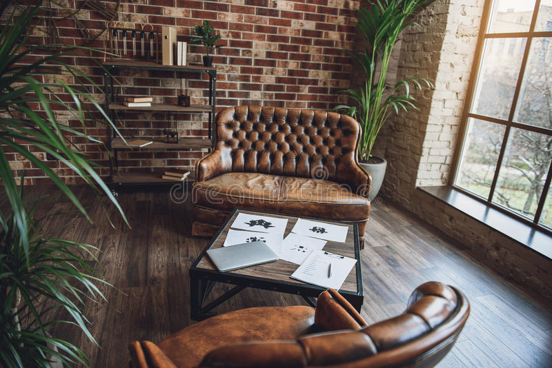 Room furnished in loft style royalty free stock image