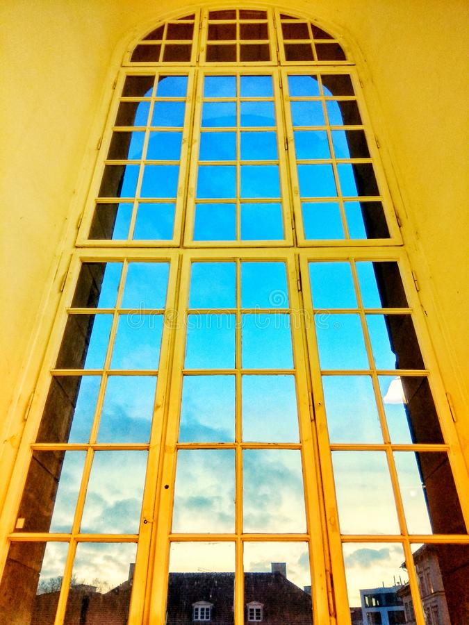 Room with a huge yellow window. With a blue sky view stock images