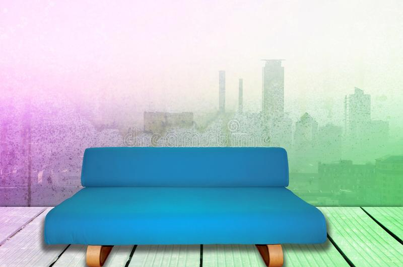 Room interior with blue sofa and city skyline view. With copy space for text or image royalty free stock photography