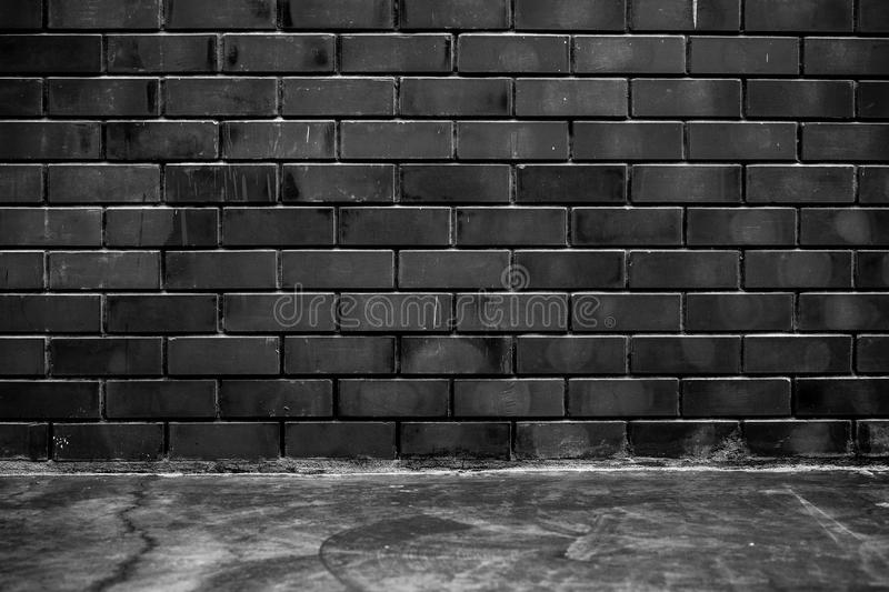 Room interior concrete floor and black brick wall texture royalty free stock photo