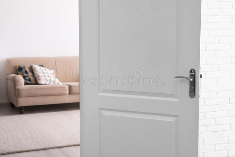 Room interior with new furniture. View through open door royalty free stock photography