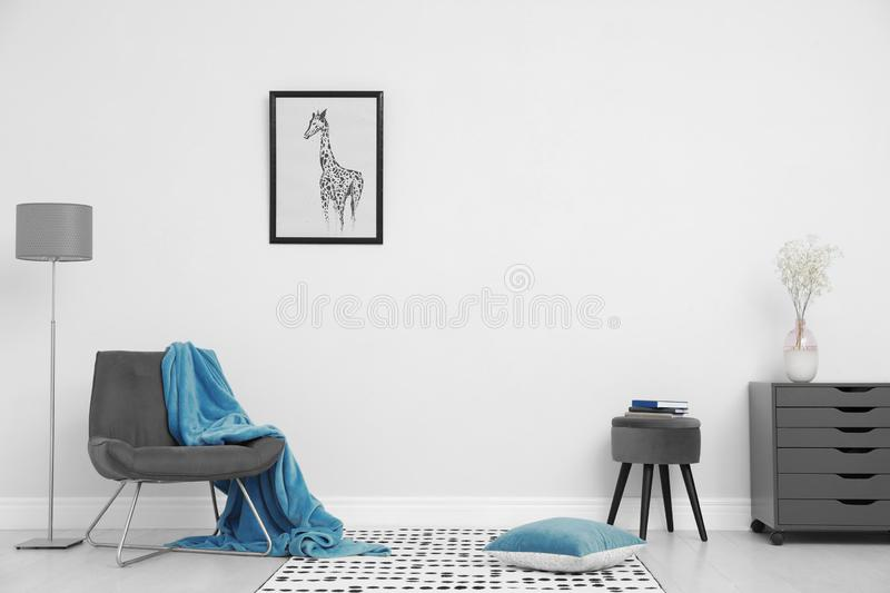 Room interior with stylish furniture near white stock image