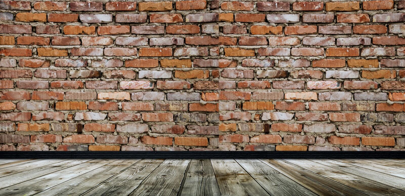 Empty room with red brick wall and wooden floor royalty free stock image