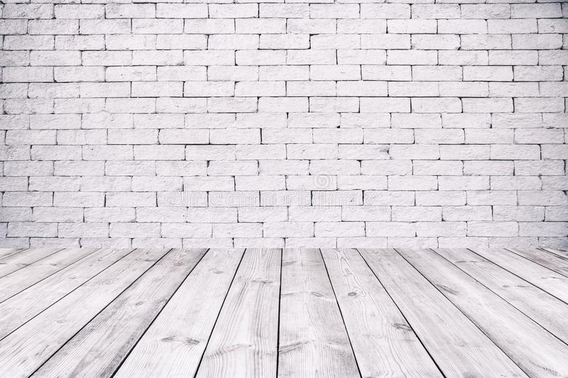 Room interior with white brick wall and wooden floor royalty free stock photos