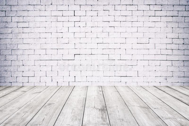 Room interior with white brick wall and wooden floor stock image