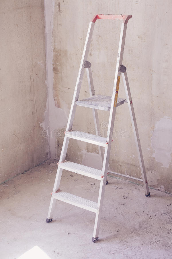 Room with ladder and wall background stock images