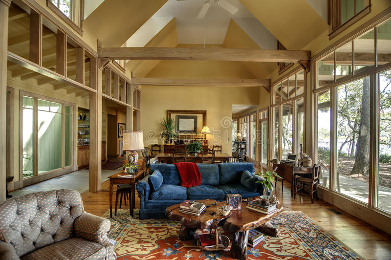 Room with large windows and vaulted ceiling stock images