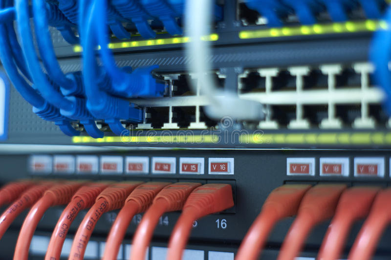 Room link, networked cables, category 6, switch and routers in the communications room. Blurred background. Room link, networked cables, category 6, switch and royalty free stock image