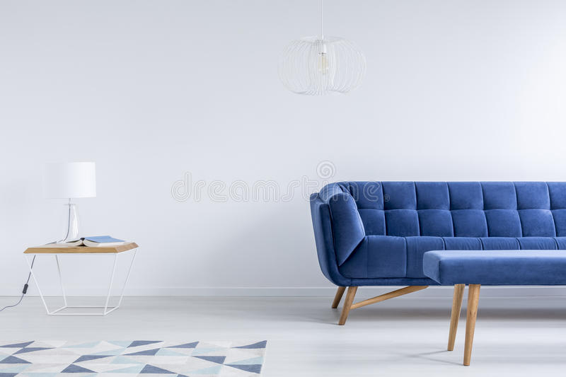 Room with navy blue couch stock image