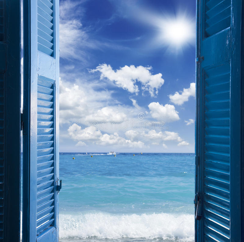Room with open door to seascape. Room with open blue door to seascape - vacation concept royalty free stock photography