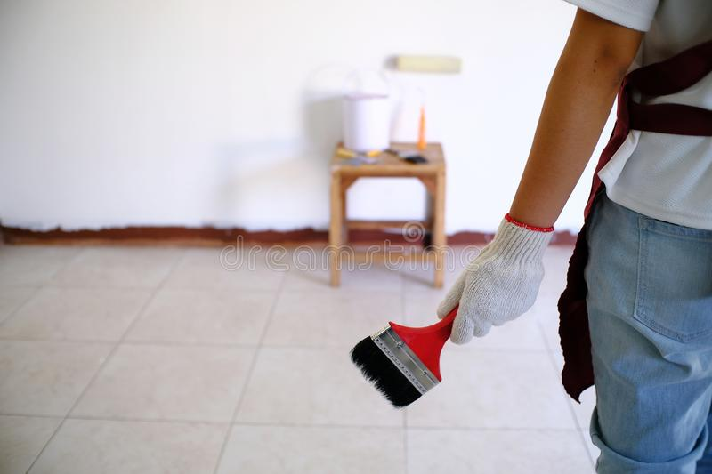 Room Painting Job painter man with roller. royalty free stock photos