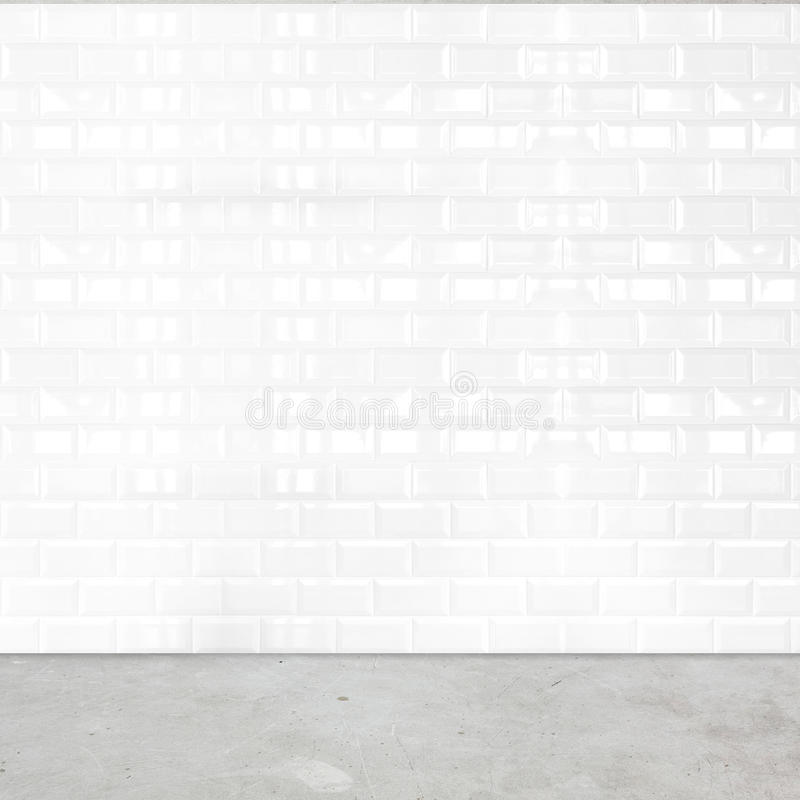 Room perspective, white ceramic tile wall and cement ground.  royalty free stock photography