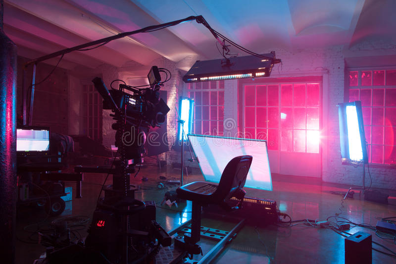 Room with equipment for a film. Room in the purple light with equipment for a film stock image