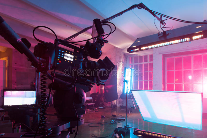 Room with equipment for a film. Room in the purple light with equipment for a film stock photography
