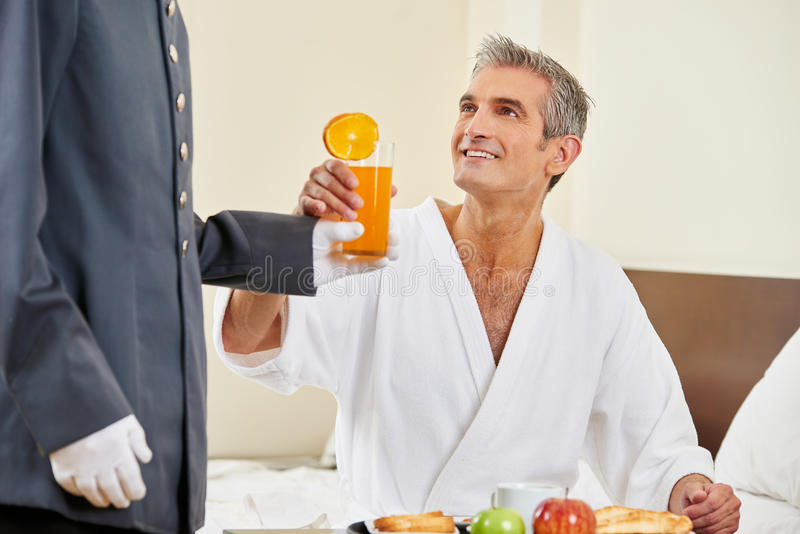 Room service bringing breakfast with orange juice. To a hotel room guest royalty free stock photos