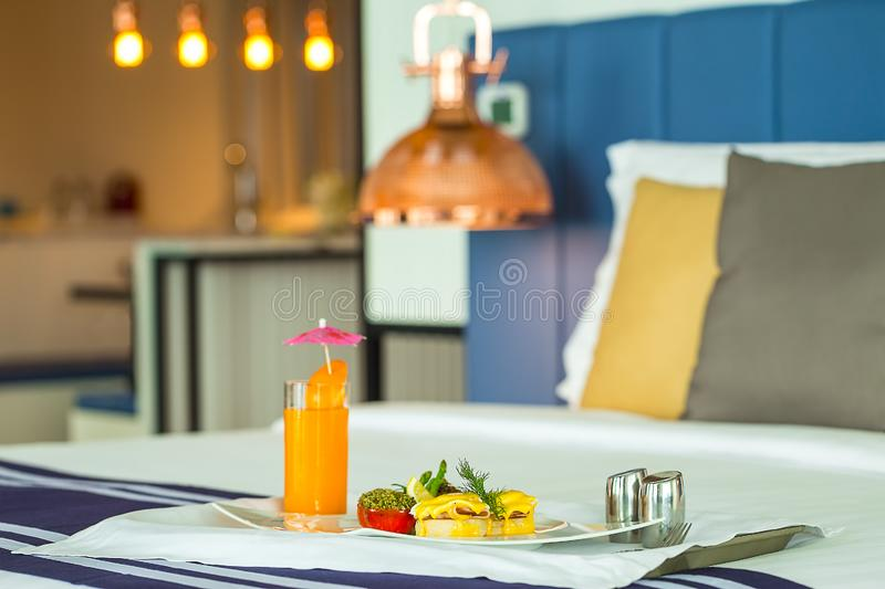 Room service serving baked bread topped with ham, braised scallo royalty free stock image