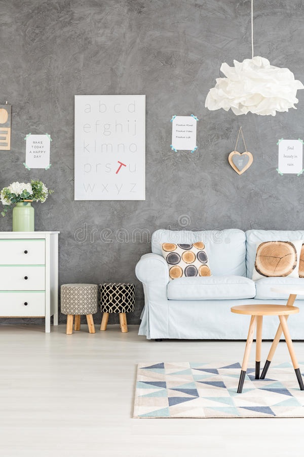 Room with sofa and stools royalty free stock image
