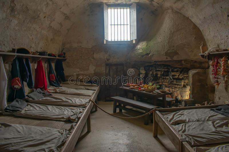 Room of Spanish soldiers of the 17th century, recreating their life in the fort  in Florida`s Historic Coast  . St. Augustine, Florida. March 31 , 2019 . Room royalty free stock image