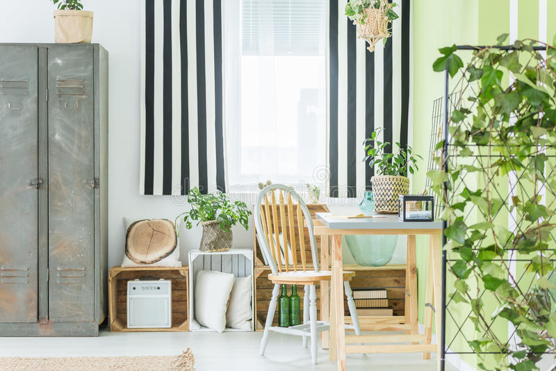 Room with striped window curtain stock photography