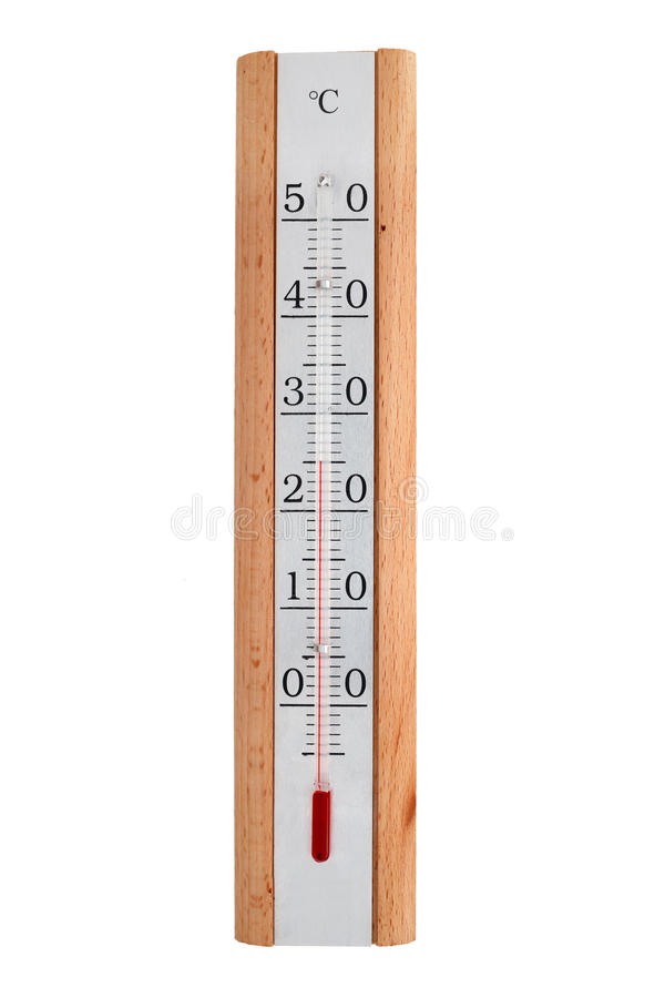 The room thermometer on a metal plate in a wooden frame shows twenty five degrees Celsius. Isolated on white background stock photography