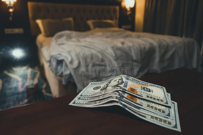 room tip. bed and money to symbolize the cost of sex. Paid love the prostitute. Payment for the services of prostitutes. A tip for royalty free stock image