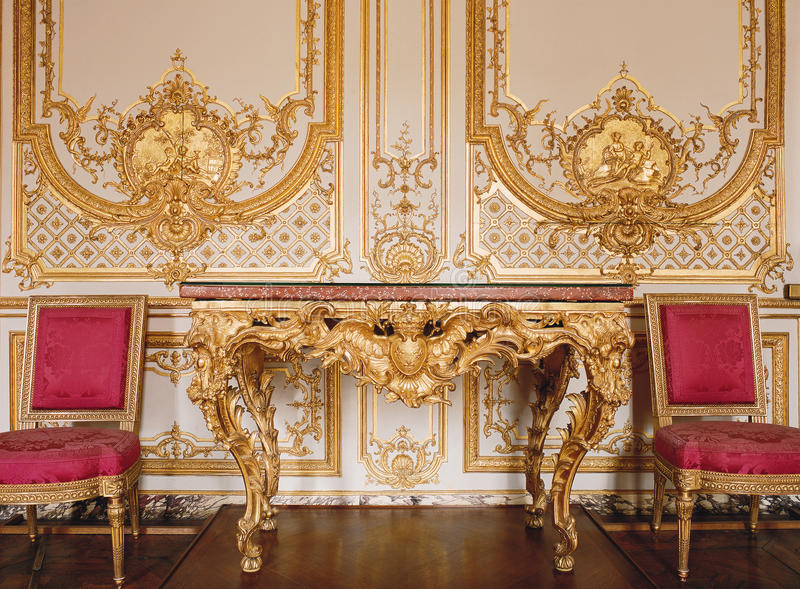 Versailles, France - 10 August 2014 : Wood wall with gold ornaments at Versailles Palace ( Chateau de Versailles ) stock images