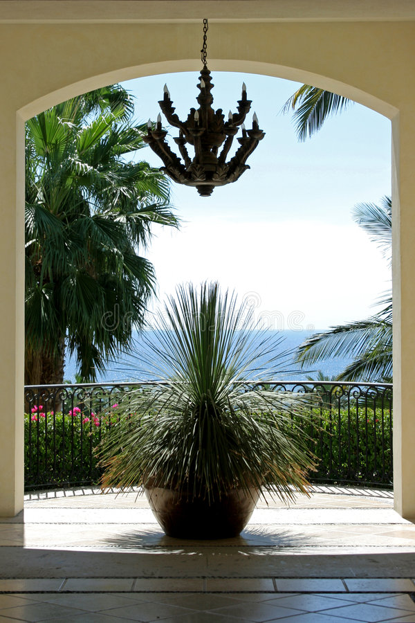 Room with a view. A tropical view through a doorway of a resort in Cabo, Mexico stock image