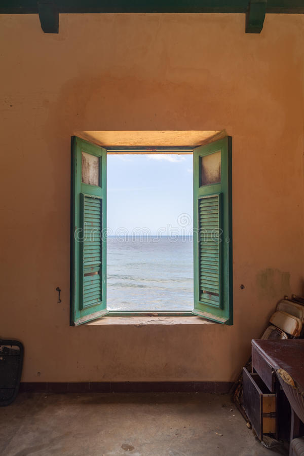 Room with a view. Abandoned place at Old San Juan (Puerto Rico) with a view to Atlantic Ocean stock photo