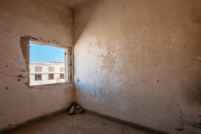 Room and window inside abandoned building , run down flat.  stock image