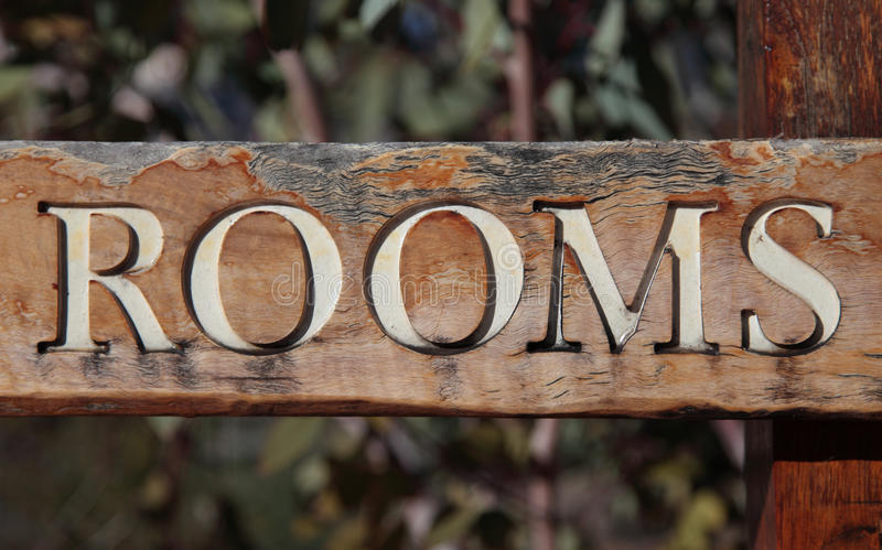 Rooms. The term rooms on a rustic wooden sign stock photography